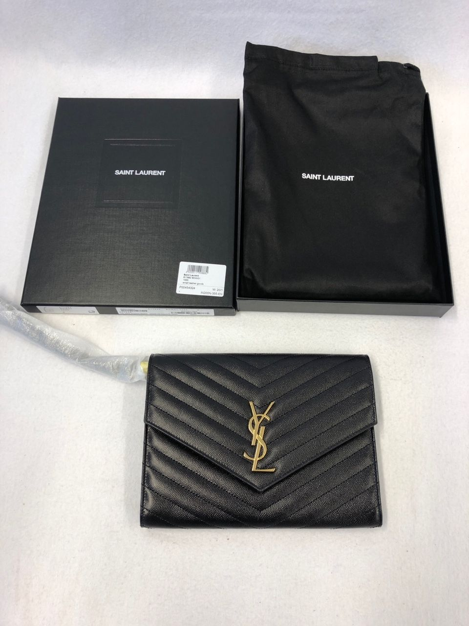 Saint Laurent Monogram leather clutch P00454324